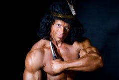 Homem atlético forte com uma faca imagens de stock royalty free