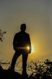 Homem atrás do sol Foto de Stock Royalty Free