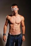 Homem atractive novo com vidros listrados fotografia de stock royalty free