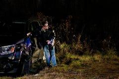 Homem bêbedo após um acidente de transito Fotografia de Stock Royalty Free
