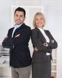 Homem bem sucedido e equipe fêmea do negócio: mana superior e júnior Imagens de Stock Royalty Free