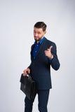 Homem bem sucedido novo com uma pasta cara Fotografia de Stock Royalty Free