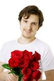 Homem bonito com um ramalhete das rosas fotografia de stock royalty free