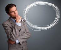 Homem bonito que pensa sobre a bolha do discurso ou do pensamento com co Foto de Stock Royalty Free