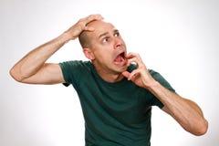 Homem cômico amedrontado Foto de Stock Royalty Free