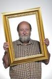 Homem calvo com um frame Imagem de Stock Royalty Free