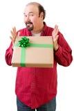 Homem calvo generoso que dá ou que recebe o presente foto de stock