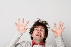 Homem chocado que olha acima com sua boca aberta Fotografia de Stock