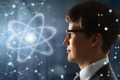 Homem com átomo imagem de stock