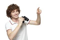 Homem com apontar binocular no espaço da cópia Fotografia de Stock Royalty Free
