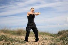 Homem com arma Fotos de Stock