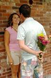 Homem com as flores para sua amiga Imagens de Stock Royalty Free