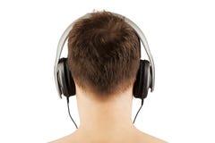 Homem com auscultadores que escuta a música. DJ Foto de Stock