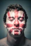 Homem com a bandeira britânica na cara e nos olhos fechados Fotos de Stock Royalty Free