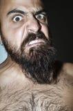 Homem com a barba com expressões frightening Imagem de Stock Royalty Free