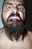 Homem com a barba com expressões frightening Fotografia de Stock Royalty Free