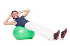 Homem com a bola suíça que faz exercícios Imagens de Stock Royalty Free