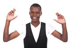 Homem com braços abertos e os dedos cruzados imagem de stock royalty free
