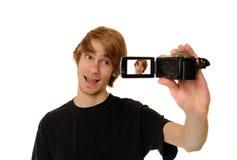 Homem com câmara de vídeo de HD foto de stock