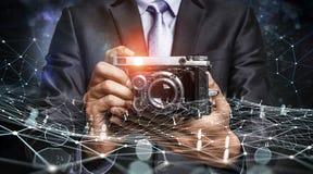Homem com a câmera nas mãos Imagem de Stock Royalty Free