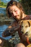 Homem com cão Imagem de Stock