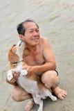 Homem com cão do lebreiro Imagens de Stock