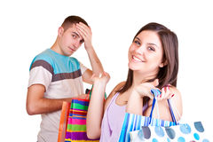 Homem com carteira e mulher com sacos Fotografia de Stock