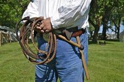 Homem com chicote e machado Foto de Stock Royalty Free