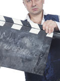 Homem com clapperboard Imagens de Stock