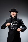 Homem com clapperboard do filme Foto de Stock Royalty Free