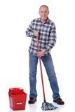 Homem com cubeta e espanador Imagens de Stock Royalty Free