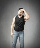 Homem com dor de cabeça Imagens de Stock Royalty Free