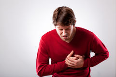 Homem com dor no peito Foto de Stock Royalty Free