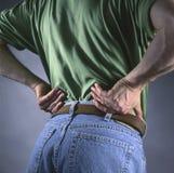 Homem com dor traseira fotografia de stock royalty free