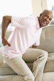 Homem com dor traseira Fotos de Stock