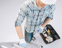 Homem com escada, conjunto de ferramentas e chave inglesa Foto de Stock Royalty Free