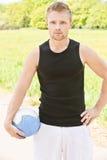 Homem com esfera do voleibol Imagem de Stock Royalty Free