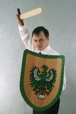 Homem com espada e protetor Foto de Stock