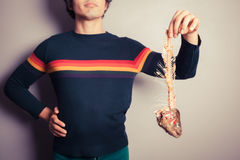 Homem com esqueleto dos peixes Fotografia de Stock