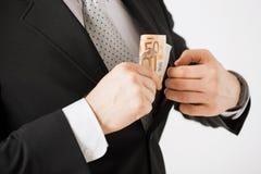Homem com euro- dinheiro do dinheiro fotografia de stock royalty free
