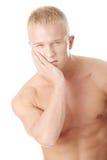 Homem com expressão da dor Foto de Stock Royalty Free