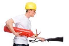 Homem com extintor Fotografia de Stock Royalty Free