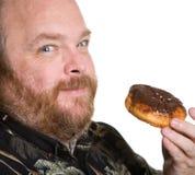 Homem com filhós do chocolate Fotografia de Stock Royalty Free