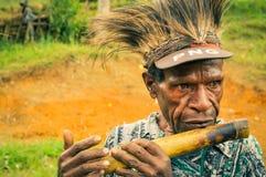Homem com flauta foto de stock