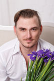 Homem com flores Fotografia de Stock