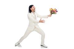 Homem com flores da tulipa Fotografia de Stock