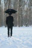 Homem com guarda-chuva Imagens de Stock