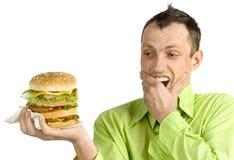 Homem com Hamburger fotografia de stock royalty free