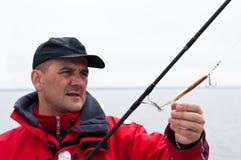 Homem com haste de pesca imagens de stock royalty free