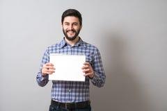 Homem com livro de texto Fotografia de Stock
